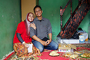 Asma Yunidar with her husband Fauzan Yunidar at their family home in Indonesia.<br /> <br /> Asma runs her own snack business, making pasties, donuts, crisps and other snacks from her small home kitchen. <br /> <br /> After attending the business training she learnt how to keep her books accurately and she has now realised she earns more than her husband.