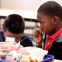 Adam Robison | BUY AT PHOTOS.DJOURNAL.COM<br /> Gavin Starks, a first grader at Thomas Street Elementary School, smells his sweet potato before tasting it during lunch Thursday.