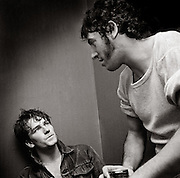 Photo of Bono and Bruce Springsteen back stage after U2 concert  at the Hammersmith Palais London 1981