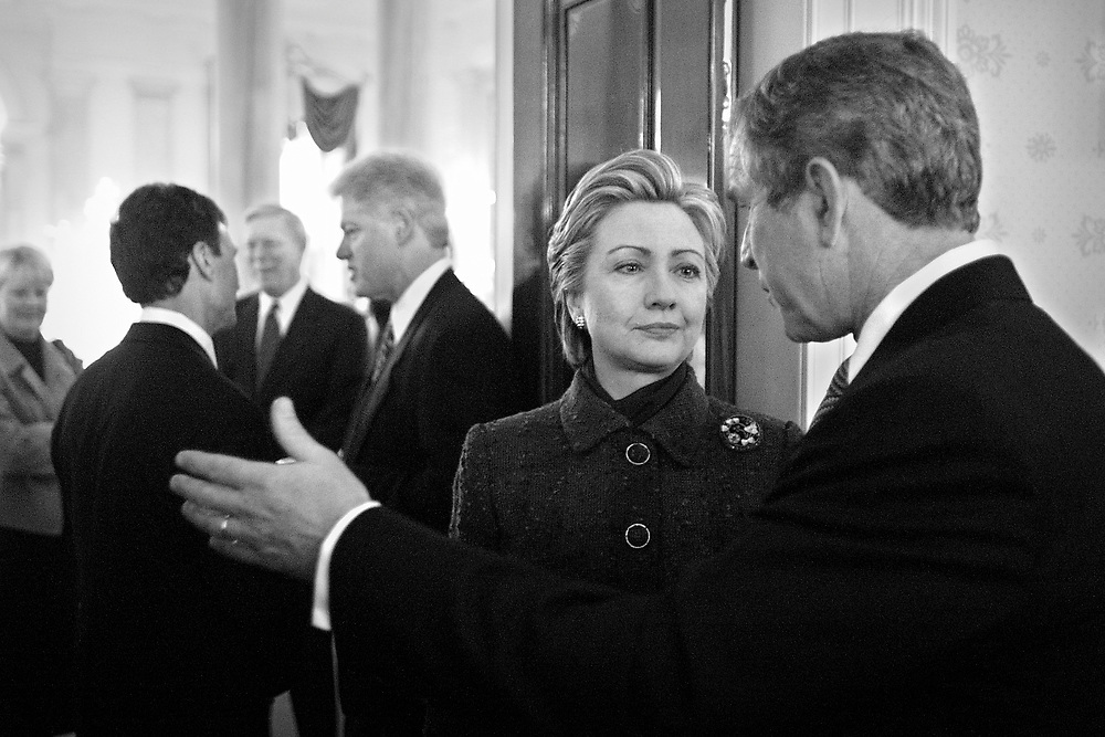 During the pre-inaugural coffee at the White House, Hillary listens to George W. Bush has President Clinton talks with Sen. Tom Daschle.