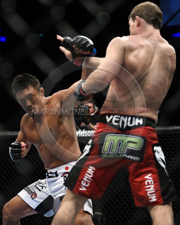 "LONDON, ENGLAND, OCTOBER 2010: Yoshihiro Akiyama (left) has a punch blocked by Michael Bisping during ""UFC 120: Bisping vs. Akiyama"" inside the O2 Arena in Greenwich, London"