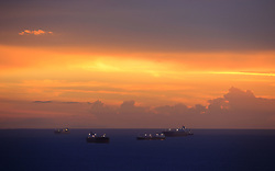 September 3, 2017 - Bahia De Pozuelos, Anzoategui, Venezuela - Oil vessels remain anchored waiting for entry to the quay to supply oil and are observed by residents during a sunset, in the Bay of Pozuelos, Anzoategui state. Venezuela. Photo: Juan Carlos Hernandez (Credit Image: © Juan Carlos Hernandez via ZUMA Wire)