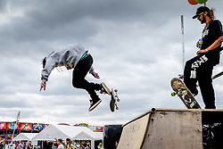 Skateboarders at the Brownstock Festival in Essex.