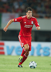 GUANGZHOU, CHINA - Wednesday, July 13, 2011: Liverpool's Martin Kelly in action against Guangdong Sunray Cave during the first pre-season friendly on day three of the club's Asia Tour at the Tianhe Stadium. (Photo by David Rawcliffe/Propaganda)