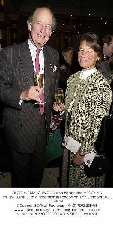 VISCOUNT MARCHWOOD and his fiancee MRS SYLVA WILLIS-FLEMING, at a reception in London on 15th October 2001.	OTB 34