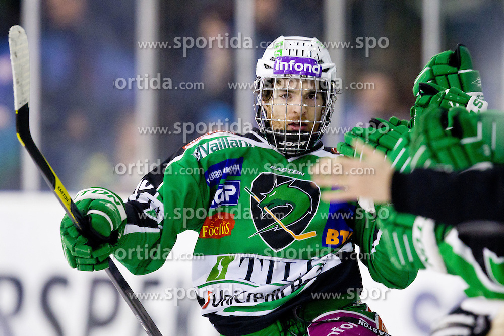 Brock McBride (HDD Tilia Olimpija, #10) celebrates during ice-hockey match between HDD Tilia Olimpija and SAPA Fehervar AV19 at sixth match in Quarterfinal  of EBEL league, on March 1, 2012 at Hala Tivoli, Ljubljana, Slovenia. HDD Tilia Olimpija won 4:3. (Photo By Matic Klansek Velej / Sportida)