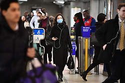 © Licensed to London News Pictures. 10/03/2020. London, UK. A passenger wearing a medical mask at Westminster Underground Station in central London. New cases of the COVID-19 strain of Coronavirus are being reported daily as the government outlines it's plans for controlling the outbreak. Photo credit: Ben Cawthra/LNP