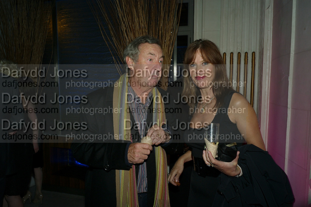 Nick Mason; Nettie Mason, The party following the opening night of 'Oliver!', at the Waldorf Hotel. London.  on January 14, 2009 *** Local Caption *** -DO NOT ARCHIVE -Copyright Photograph by Dafydd Jones. 248 Clapham Rd. London SW9 0PZ. Tel 0207 820 0771. www.dafjones.com<br /> Nick Mason; Nettie Mason, The party following the opening night of 'Oliver!', at the Waldorf Hotel. London.  on January 14, 2009