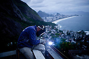 A construction worker welds a terrace onto a wall on a building that will host the first luxury hotel in Vidigal shantytown in Rio de Janeiro, Brazil on Thursday, February 28, 2013.