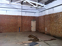 inside of right hand unit,  flooring and drainage all important