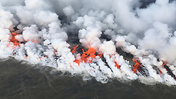 Handout photo of Lava from fissure 8 is entering the sea this morning on the southern portion of the flow front primarily through the open channel, but also along this 1 km (0.6 mi) wide area with multiple laze plumes from smaller oozing lobes. KÄ«lauea Volcano, HI, USA, June 26, 2018. Photo by USGS via ABACAPRESS.COM