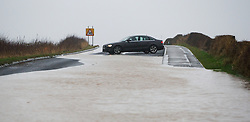 © Licensed to London News Pictures. 25/11/2012..North East England..Heavy overnight rain caused traffic disruption and flooding in parts of Cleveland and North Yorkshire this morning. This car turned back after coming across a deep flooded stretch of a road in North Yorkshre...Photo credit : Ian Forsyth/LNP