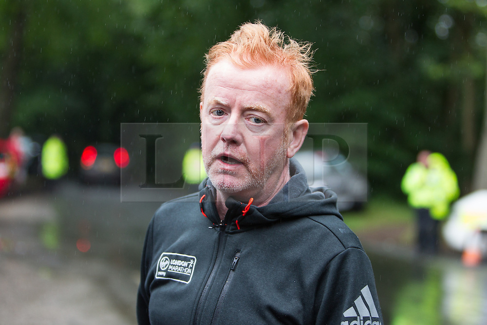 © Licensed to London News Pictures . 01/08/2015 . Cheshire , UK . CHRIS EVANS delivers a statement from the top of Coach Road , along which the plane has crashed . Scene in Oulton Park , Cheshire , where a plane has crashed and one person has died this afternoon (1st August 2015) during the Carfest2015 event . Photo credit : Joel Goodman/LNP