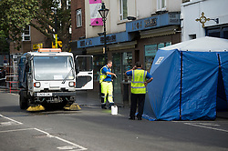 © London News Pictures. 30/08/2014. London, UK. A police tent in a cordoned off area of Portobello Road in West London today (30/08/2014) the scene of a fatal stabbing . A murder investigation has been launched after a Man aged in his fifties died of stab wounds in the early hours of this morning. Respect party politician George Galloway was alleged assaulted in the same area late yesterday evening. Photo credit : Ben Cawthra/LNP