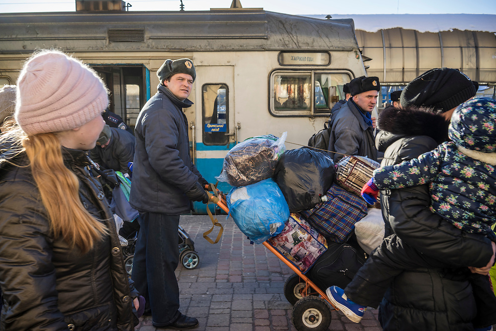 Luggage belonging to people displaced by fighting around the town of Debaltseve upon the group's arrival by train on Thursday, February 12, 2015 in Kharkiv, Ukraine. The group spent several hours in Kharkiv before boarding a train that will take them to Lviv, on the Western side of the country.