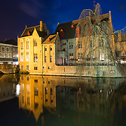 "Sometimes called ""The Venice of the North,"" the historic Flemish city of Bruges has canals running through the old town. Before the water access became silted up, Bruges was a major commercial port. The building in the center of frame is the 15th century mayor's house, the Perez de Malvenda, where the Holy Blood was kept."