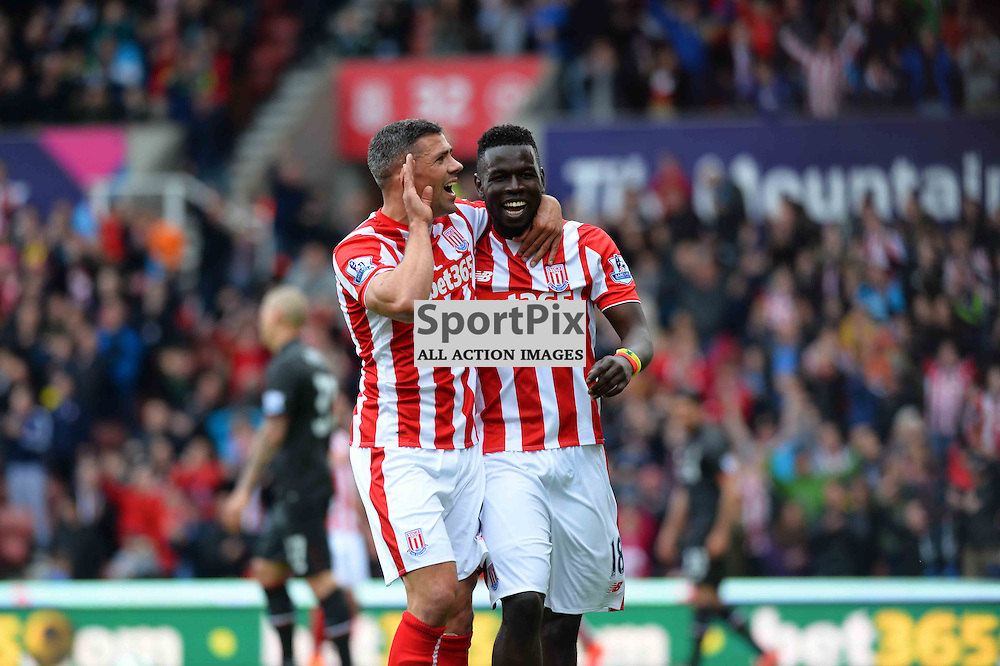 Mame Diouf scores the first goal for Stoke and his celebrates with Jonathan Walters