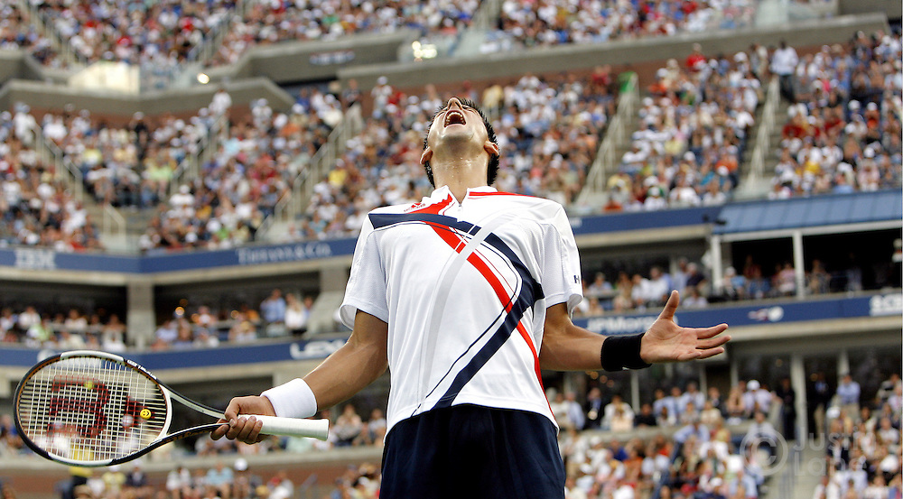 Novak Djokovic reacts after missing a shot while playing Roger Federer in the men's final of the 2007 US Open.