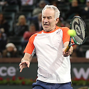 March 1, 2014, Indian Wells, California: <br /> John McEnroe hits a forehand during the McEnroe Challenge for Charity presented by Esurance in Stadium 2 at the Indian Wells Tennis Garden. <br /> (Photo by Billie Weiss/BNP Paribas Open)