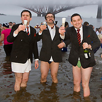 SOUTH QUEENSFERRY, SCOTLAND - JANUARY 01: 'Loony Dookers' take their annual plunge in the freezing waters of the Firth of Forth on January 01, 2008 in South Queensferry, Soctland. The Loony Dook, a famous event now in it's 22nd year, involves people dressing up and jumping in to the cold waters of the Firth of Forth to raise money for charity and celebaret the New Year.