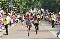 LONDON - AUGUST 12: Stephen Kiprotich wins Gold for Uganda, Abel Kirui wins Silver for Kenya and Wilson Kipsang Kiprotich wins Bronze for Kenya in the Men's Marathon, Birdcage Walk, London, UK. August 12, 2012. (Photo by Richard Goldschmidt)