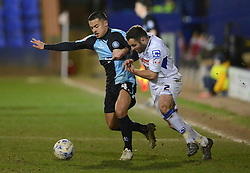 Wycombe Wanderers's Nicholas Yennaris competes with Tranmere Rovers's Danny Holmes - Photo mandatory by-line: Richard Martin-Roberts/JMP - Mobile: 07966 386802 - 03/03/2015 - SPORT - football - Tranmere - Prenton Park - Tranmere Rovers v Wycombe Wanderers - Sky Bet League Two