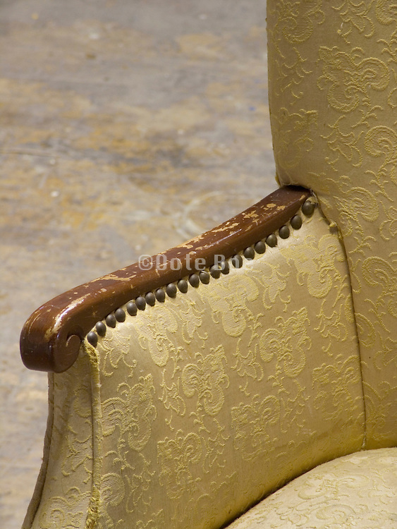 close up of the arm of an old chair