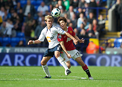 BOLTON, ENGLAND - Sunday, September 26, 2010: Manchester United's Ji-Sung Park and Bolton Wanderers' Stuart Holden during the Premiership match at the Reebok Stadium. (Photo by David Rawcliffe/Propaganda)