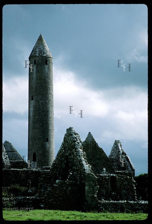 Kilmacduagh round tower (112') looms behind church bldgs where St Colman founded monastery;Gort Ireland