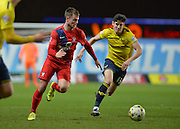 York City midfielder James Berrett takes on Oxford United Midfielder Callum O-Dowda during the Sky Bet League 2 match between Oxford United and York City at the Kassam Stadium, Oxford, England on 1 March 2016. Photo by Adam Rivers.