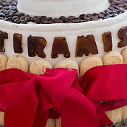 A Tiramisu Cake is displayed at the entrance of one of the stands of the Biennale del Gusto on October 28, 2013 in Venice, Italy. The Biennale del Gusto is an exhibition held over four days, dedicated to traditional food and drinks from all regions of Italy.