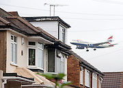 "© Licensed to London News Pictures. 01/09/2014. Bedfont, UK TODAY PICTURE. Planes land at Heathrow airport on 1st September 2014. Mayor of London, Boris Johnson, has issued a last ditch appeal in his battle to prevent a third runway being built at Heathrow, insisting it would be ""barbarically contemptuous"" of local residents.  Photo credit : Stephen Simpson/LNP"
