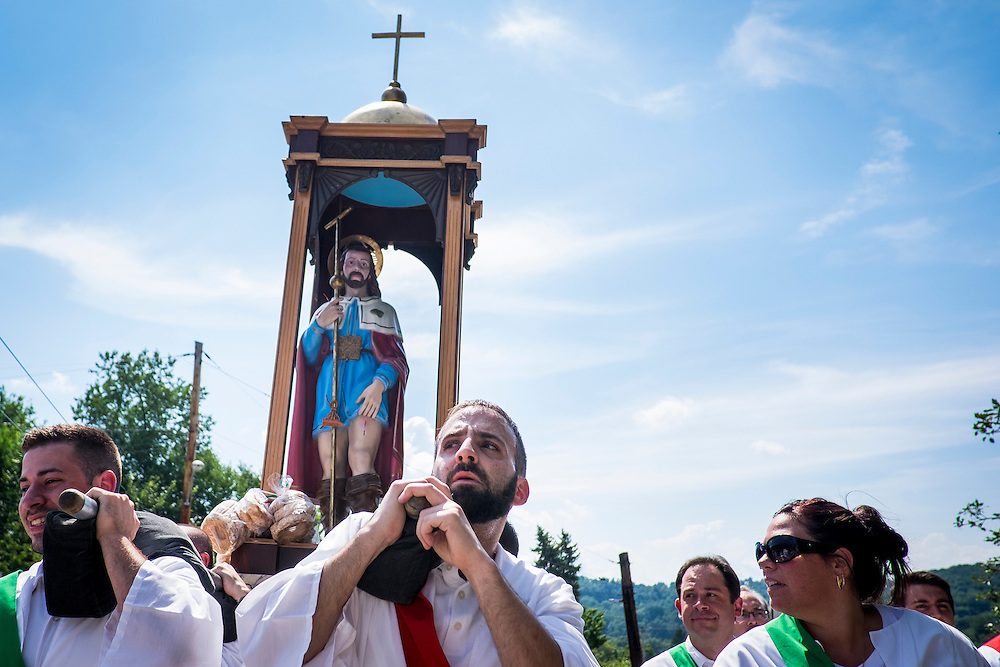 The 90th San Rocco Festa procession makes its way through Sheffield Terrace in Aliquippa. The festival, a three-day religious celebration, is held annually in August honoring St. Rocco, a patron saint of the city of Potenza, Italy where many Italians in Aliquippa can trace their ancestry.