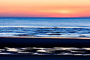Graphic sunrise photographed while on sea turtle patrol for NEST in Corolla on the Outer Banks of NC.