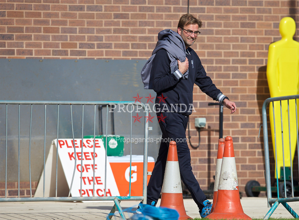 "LIVERPOOL, ENGLAND - Wednesday, May 4, 2016: Liverpool's manager Jürgen Klopp walks out for a training session at Melwood Training Ground past a ""Please Keep Off The Pitch"" sign ahead of the UEFA Europa League Semi-Final 2nd Leg match against Villarreal CF. (Pic by David Rawcliffe/Propaganda)"