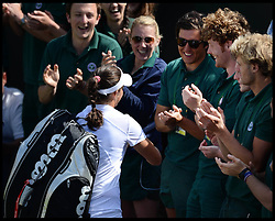 Laura Robson goes to see the groundsman (the one with the sunglasses on is believed to be her brother) after beating Marina Erakovic at<br /> The All England Lawn Tennis Club, Wimbledon, United Kingdom<br /> Saturday, 29th June 2013<br /> Picture by Andrew Parsons / i-Images