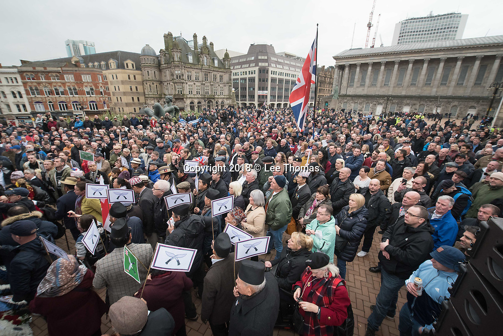 Birmingham, West Midlands, UK. 24th March 2018. Thousands of demonstrators converge on Birmingham city centre organised by three individual groups: Football Lads Alliance (FLA), Democratic Football Lads Alliance (DFLA) and Stand Up To Racism.  Pictured: The DFLA & FLA mingle at Victoria Square to listen to speeches. // Lee Thomas, Tel. 07784142973. Email: leepthomas@gmail.com  www.leept.co.uk (0000635435)