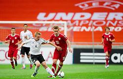 Nico Brandenburger of Germany vs Adrian Cierpka of Poland during the UEFA European Under-17 Championship Semifinal match between Germany and Poland on May 13, 2012 in SRC Stozice, Ljubljana, Slovenia. (Photo by Vid Ponikvar / Sportida.com)