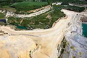 Nederland, Limburg, Gemeente Maastricht, 27-05-2013<br /> Sint-Pietersberg, close-up mergelgroeve voor de winning van mergel (eigenlijk kalksteen) in dagbouw door cementfabriek ENCI. Maastricht aan de horizon. Wat er nog resteert van de St.Pietersberg, rond de greeve, is beschermd natuurgebied en bovengronds en ondergronds aangewezen als beschermd Habitatrichtlijngebied.<br /> Marl quarry for the extraction of marl (limestone actually) in surface mining by cement factory ENCI. Maastricht at the horizon. What is left of the Sint-Pietersberg is designated as protected area, both on groundlvel and underground the habitat directives apply.<br /> luchtfoto (toeslag op standaardtarieven);<br /> aerial photo (additional fee required);<br /> copyright foto/photo Siebe Swart.