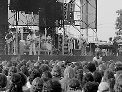 Grateful Dead, Wall of Sound and Audience. Live at Dillon Stadium, Hartford, CT 31 July 1974. This is Image No. M24-11 replacing M24-12 that was seen here for some time. This is a much better close tight crop of the full frame Hasselblad Tri-X film representing the resolution of the full image. Also, one of the only images capturing Keith. He seemed to be hiding pretty much from any angle of view at this show. Anywhere I went, and I did move around a lot, I couldn't get a good photo of Keith.