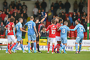 The ref shows Swindon Town Defender, Raphael Rossi Branco the red card during the EFL Sky Bet League 1 match between Swindon Town and Bolton Wanderers at the County Ground, Swindon, England on 8 October 2016. Photo by Adam Rivers.