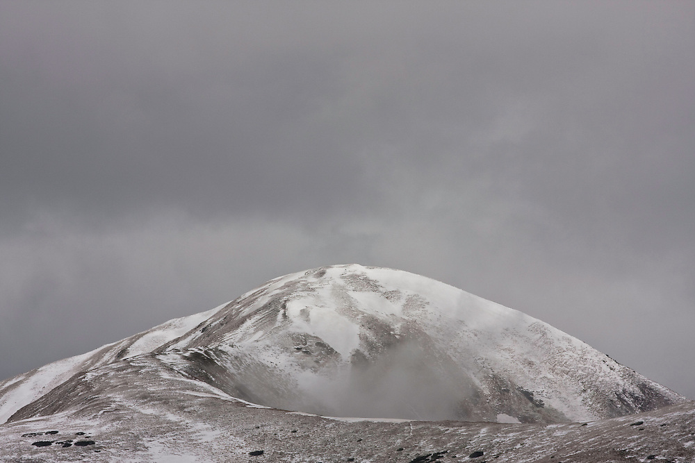 Cloudy sky and fresh snow on Mount Vel'kà kopa (2052 m asl) in the Western Tatras, Slovakia. June 2009. Mission: Ticha