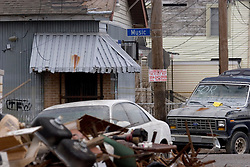 10  December, 05. New Orleans, Louisiana. Post Katrina aftermath. <br /> The day the Music died? Music street in Gentilly remains piled high with debris and flooded cars long after the devastating flood from Hurricane Katrina subsided.<br /> Photo; ©Charlie Varley/varleypix.com