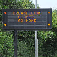 DARESBURY, UK:.Roadsign on the A533 warning that Creamfields festival had been closed early by extreme weather  on Sunday, 26th August 2012..PHOTOGRAPH BY TERRY KANE / BARCROFT MEDIA LTD..UK Office, London..T: +44 845 370 2233.E: pictures@barcroftmedia.com.W: www.barcroftmedia.com..Australasian & Pacific Rim Office, Melbourne..E: info@barcroftpacific.com.T: +613 9510 3188 or +613 9510 0688.W: www.barcroftpacific.com..Indian Office, Delhi..T: +91 997 1133 889.W: www.barcroftindia.com