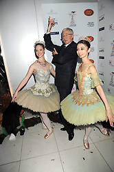 PAUL O'GRADY and dancers at a reception before the launch of the English National Ballet Christmas season launch of The Nutcracker held at the St,Martins Lane Hotel, London on 5th December 2008.