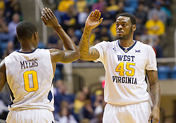 Dec 17, 2016; Morgantown, WV, USA; West Virginia Mountaineers forward Elijah Macon (45) and West Virginia Mountaineers guard Teyvon Myers (0) celebrate during the second half against the UMKC Kangaroos at WVU Coliseum. Mandatory Credit: Ben Queen-USA TODAY Sports