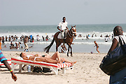 Crowds hit the beach on Sunday Afternoon. Laadi Beach. Accra.  Ghana. West Africa..Picture ©Zute Lightfoot 07939 108077.www.lightfootphoto.co.uk