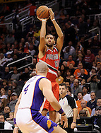Nov. 21, 2012; Phoenix, AZ, USA; Portland Trail Blazers forward Nicolas Batum (88) shoots the ball during the game against the Phoenix Suns in the first half at US Airways Center. The Suns defeated the Trail Blazers 114-87. Mandatory Credit: Jennifer Stewart-US PRESSWIRE.