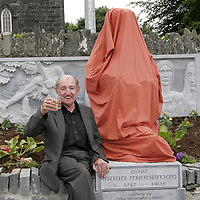 Michael Clancy wets Brian Merriman's head as a statue of the poet is unveiled in Ennistymon on Wednesday evening.<br /> <br /> Photograph by Yvonne Vaughan.