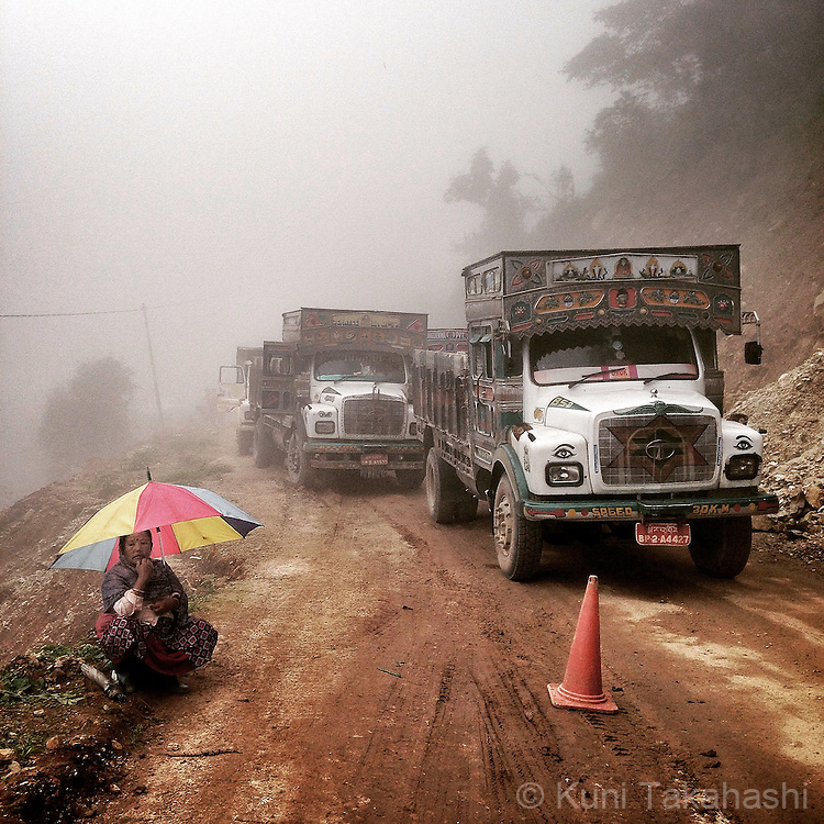 Trucks line up to wait for road opening during construction of rural mountainous road in Eastern Bhutan on Sep 8, 2015.<br /> (Photo by Kuni Takahashi)